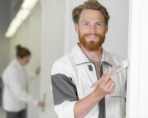 painter painting door frame
